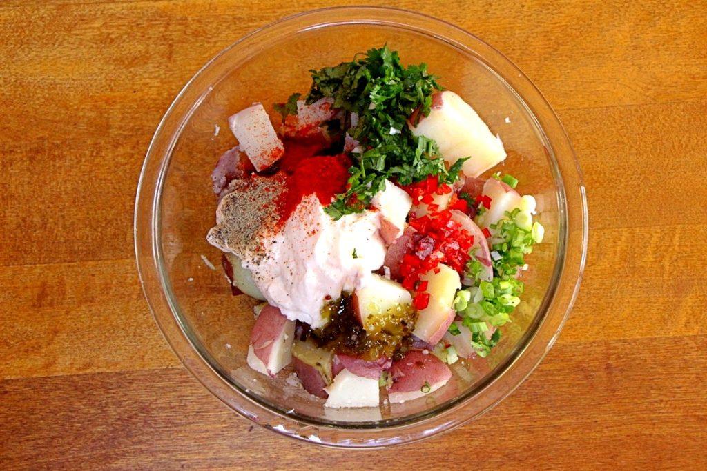 Potato salad ingredients in bowl
