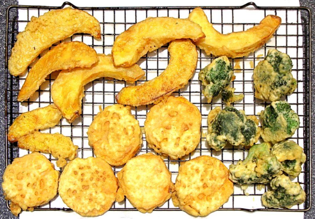 Fried gluten free vegetable tempura on cookie rack