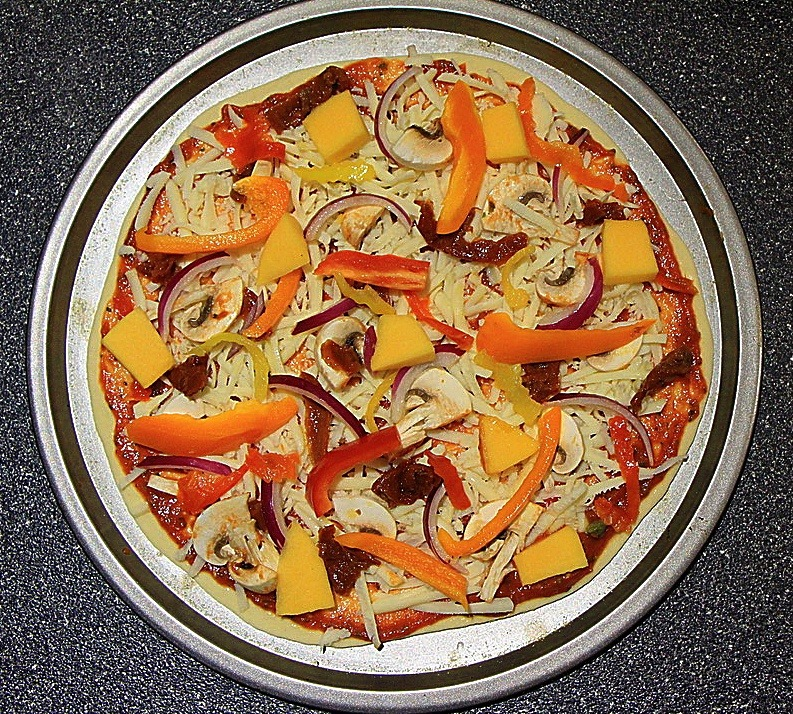 Vegetable pizza ready to be baked