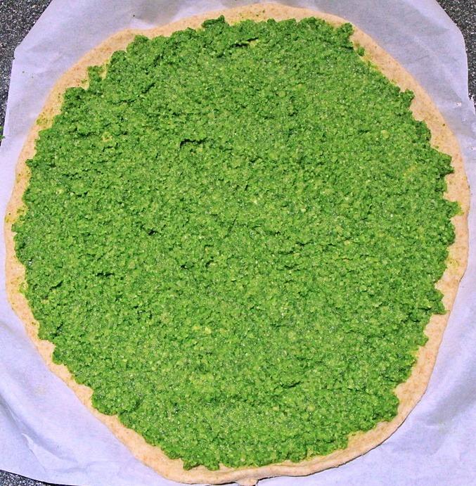 Arugula pesto spread on dough