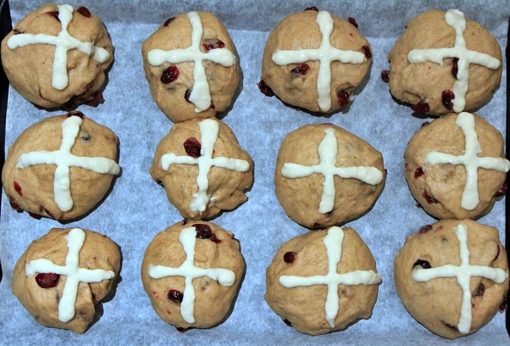Buns with crosses ready to be baked