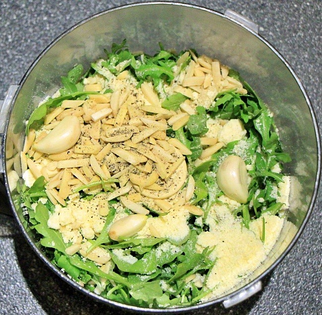 Arugula pesto ingredients in processor