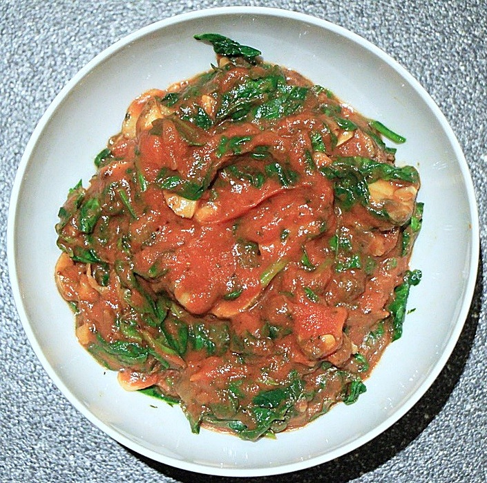 Cooked ingredients with crushed tomatoes