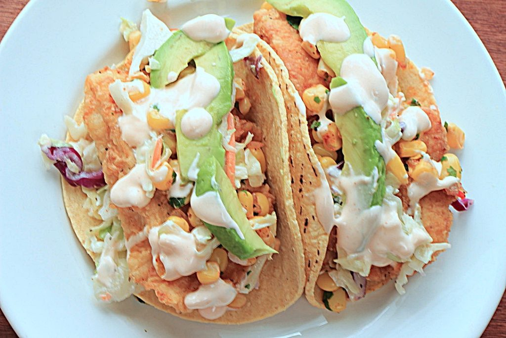 Fish taco with coleslaw and corn