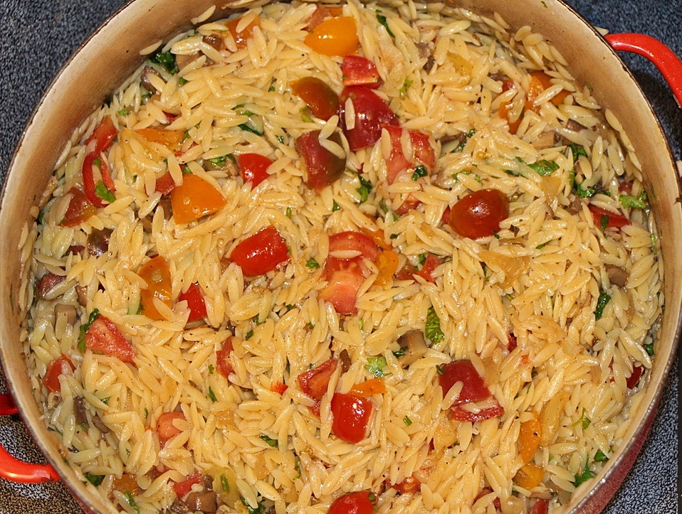 Orzo and tomatoes in a pan